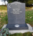"WCY20 - 2'6"" Honed Dark Grey Ogee top style Headstone, with Wheat Design painted Silver."
