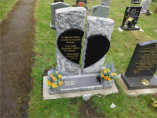 WB1 - Rustic Split Headstone with an All Polished Black Granite Broken Heart and Black Granite section on the base.