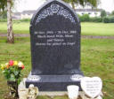 "WCE15 - 2'10"" All Polished Flint Grey Gothic style Headstone with a Carved Roses design."