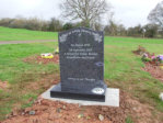 "WCE18 - 2'6"" All Polished Dark Grey Ogee style Headstone, with outlined Rose designs."