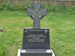 WB12 - Honed Dark Grey Headstone with a Celtic Design Cross Top and Two Bird Designs.